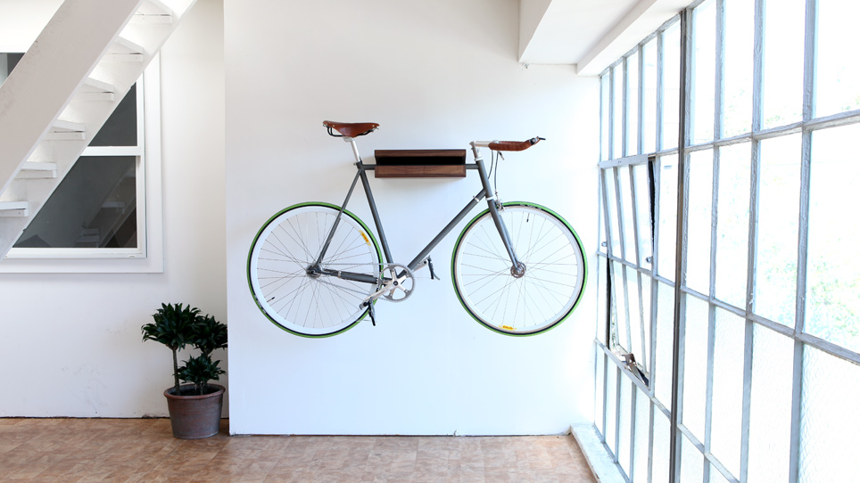 Hanging a bicycle on a Bike Shelf is a quick decorating idea to make an apartment look bigger.