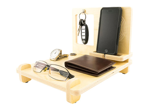 Moving to NYC tip: organize an iPhone, wallet, keys, a watch, and sunglasses on a docking station/desk organizer.