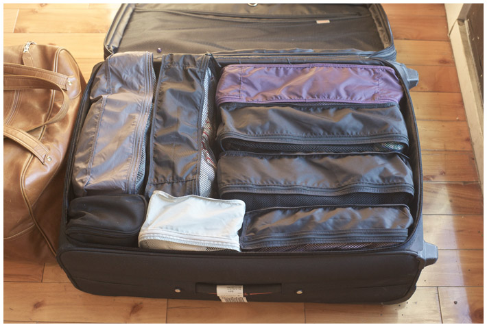 How to move from a house to an apartment: use a suitcase for out of season clothes storage.