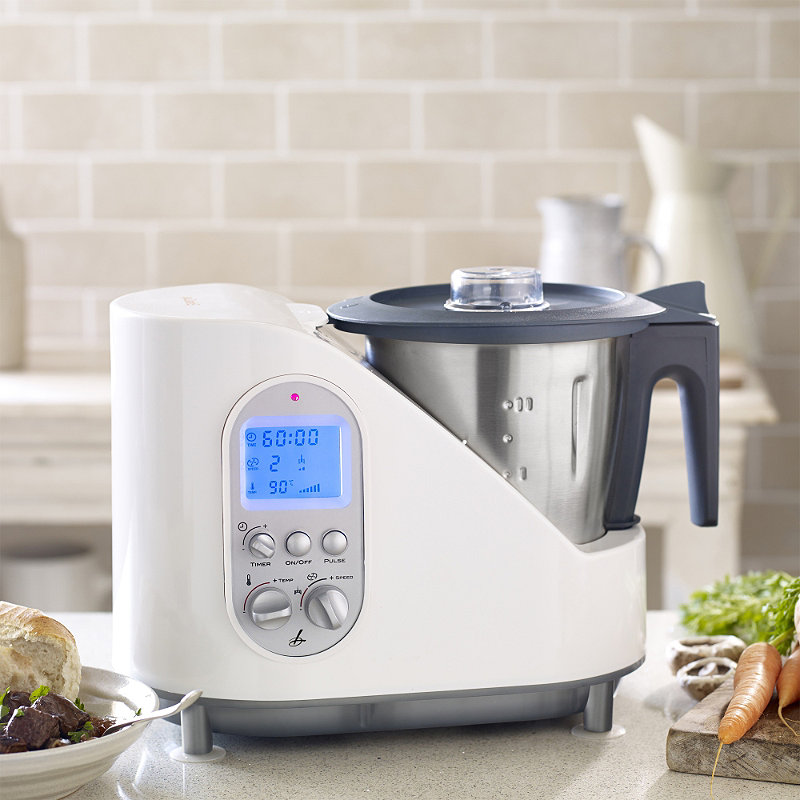 The Lakeland Multichef, which is a multi-functional kitchen appliance, is on a small kitchen counter.