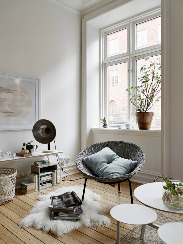 A creative natural light tip is to use light colored furniture in a tiny apartment