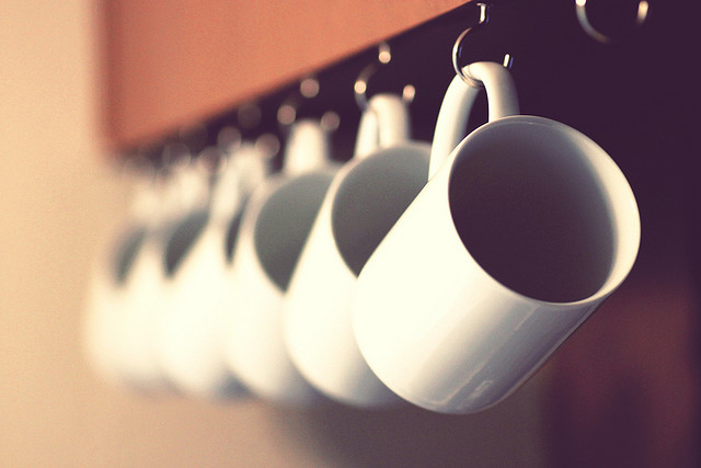 Save space in a kitchen by installing hooks for coffee mug storage.