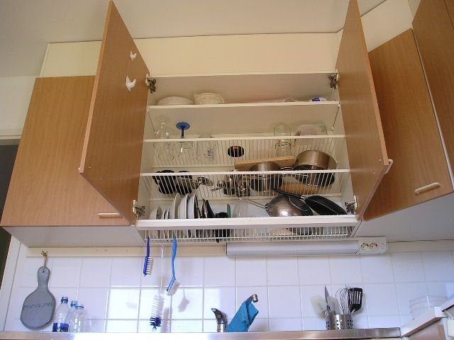 Install wire racks into a cabinet to serve as tiny kitchen storage.