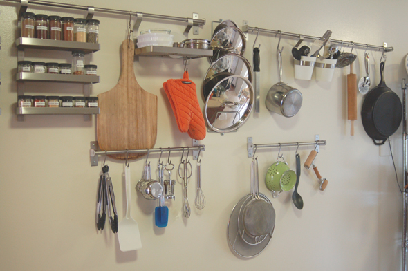 7 smart ways to save a ton of space in your small kitchen 21289 | tiny kitchen storage space saving wall mounted s hooks