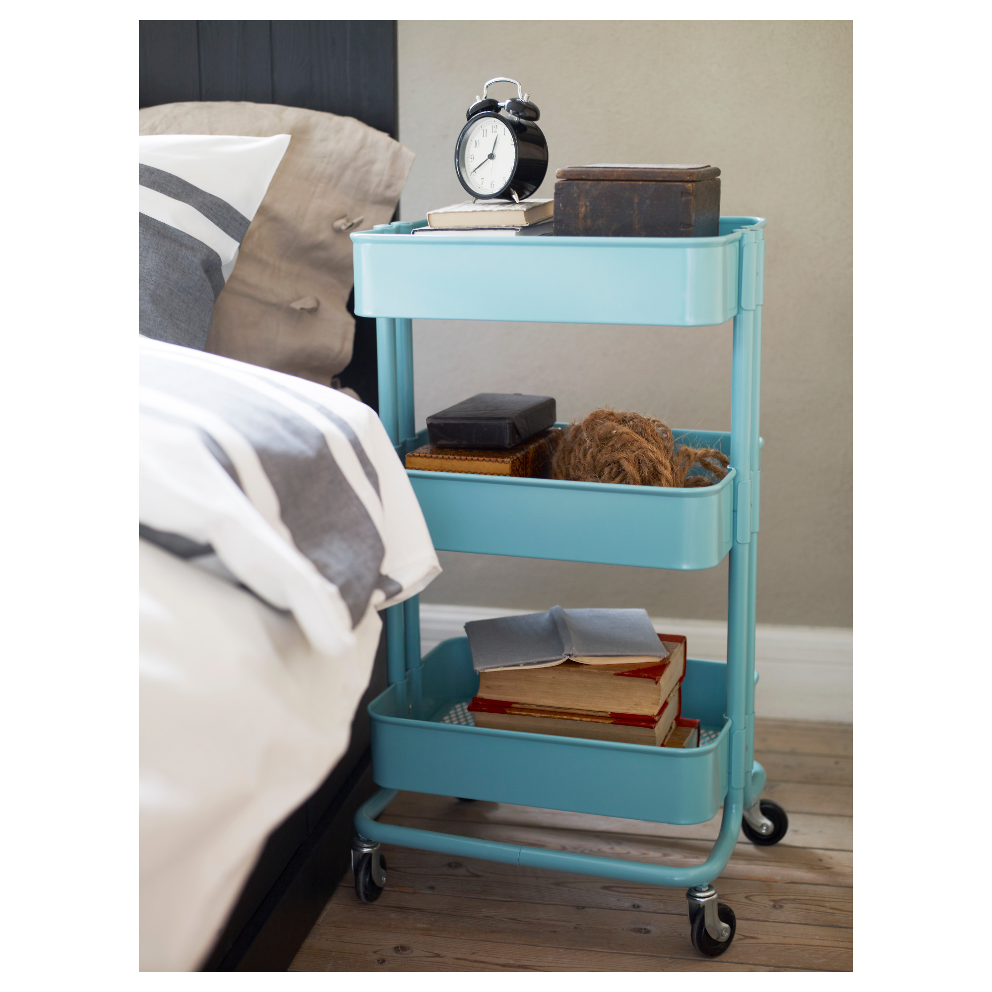An IKEA Raskog Utility Cart Used As A Bedside Table.