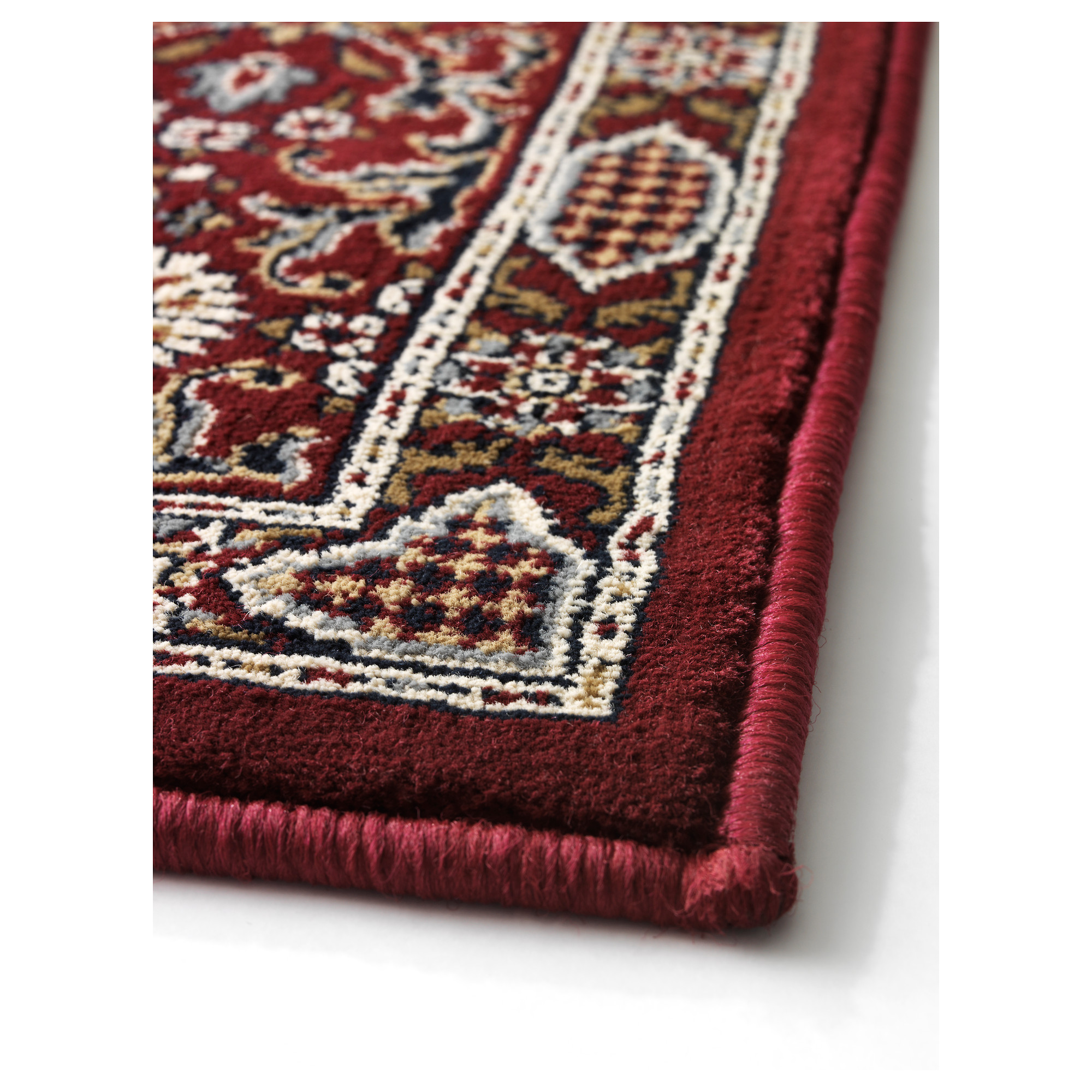 A closeup of a burgundy IKEA Valby Ruta rug.