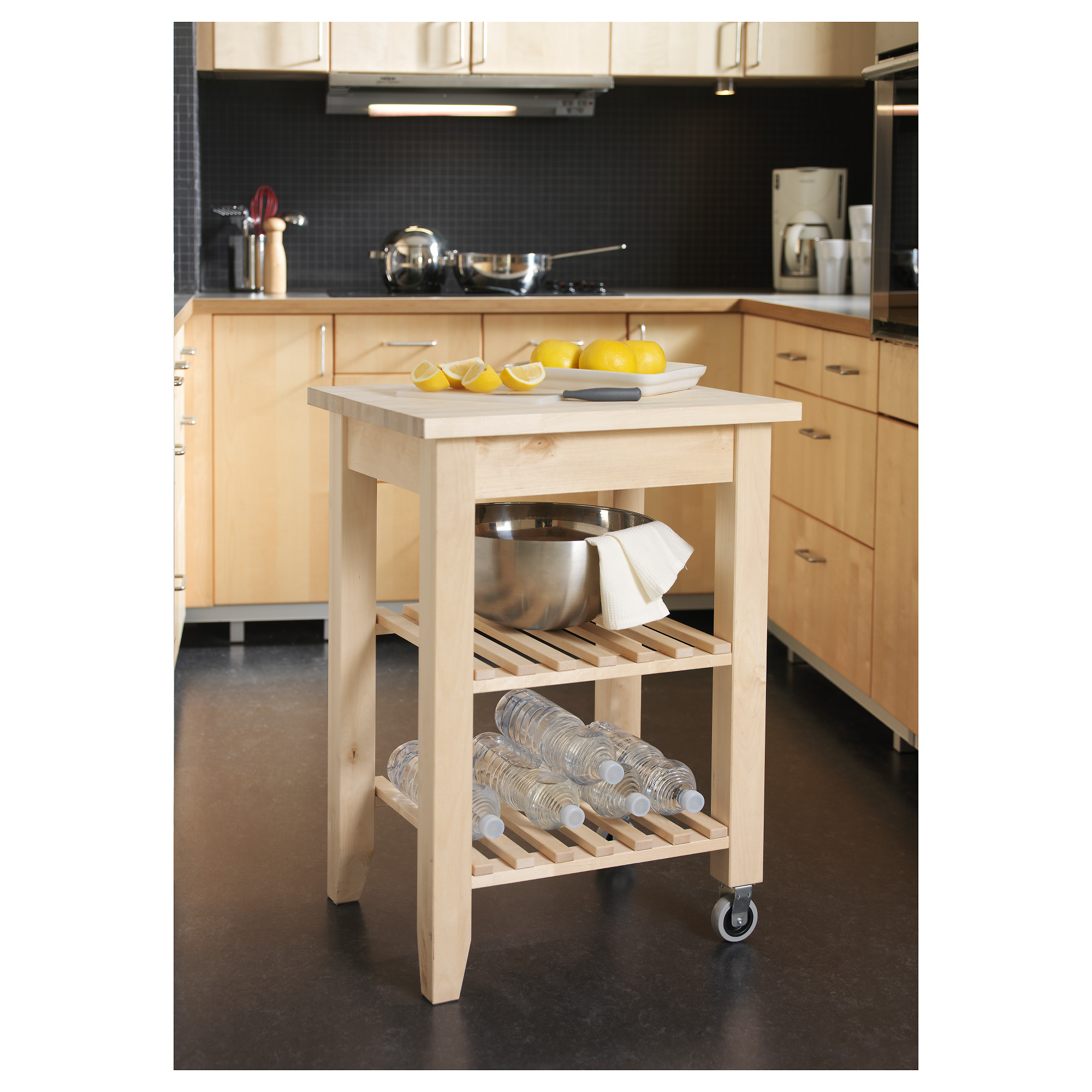 An IKEA Bekvam portable butcher block with wheels is in a clean and organized kitchen.