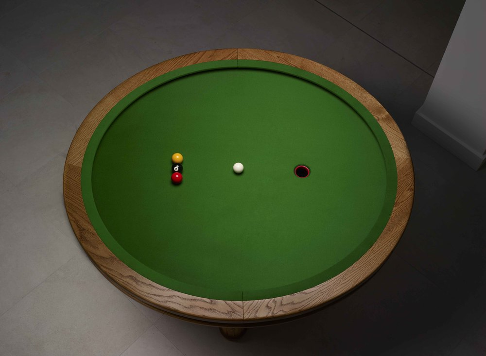 LOOP is a circular space-saving game similar to pool but played with three balls and one hole.