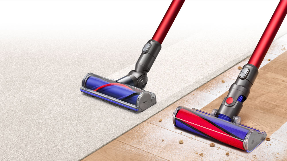 A Dyson v6 absolute sweeping a wooden floor and vacuuming a carpet.