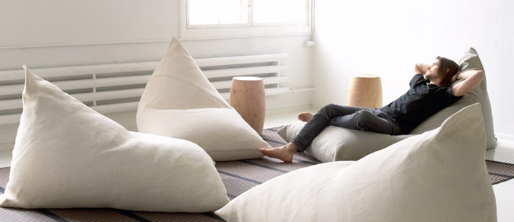 A man lying on My, a bean bag chair for adults designed by Ulla Koskinen