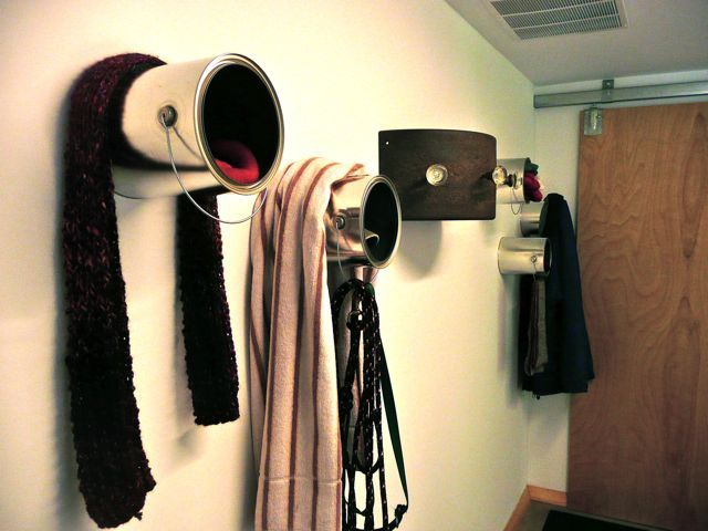 DIY scarf, winter hat, jacket, coat, gloves, and dog leash storage made of upcycled paint cans.