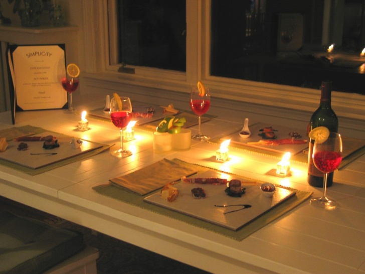 Keep the romance alive with your significant other in a tiny apartment by having a romantic date night at home that includes dinner, candles, and a bottle of wine.