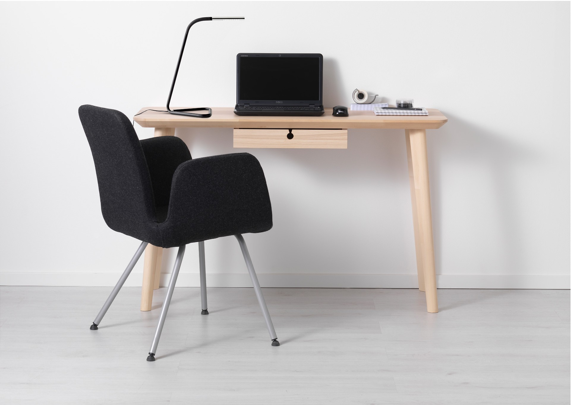 To share a tiny apartment with a boyfriend or girlfriend, downsize to a smaller desk like LISABO from IKEA.