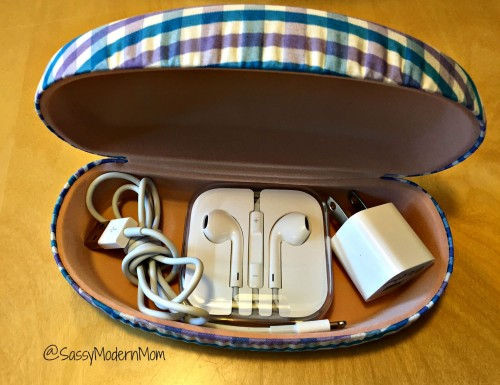 An easy storage hack is storing an iPhone charger, cable, and headphones in a sunglasses case or eyeglasses case.