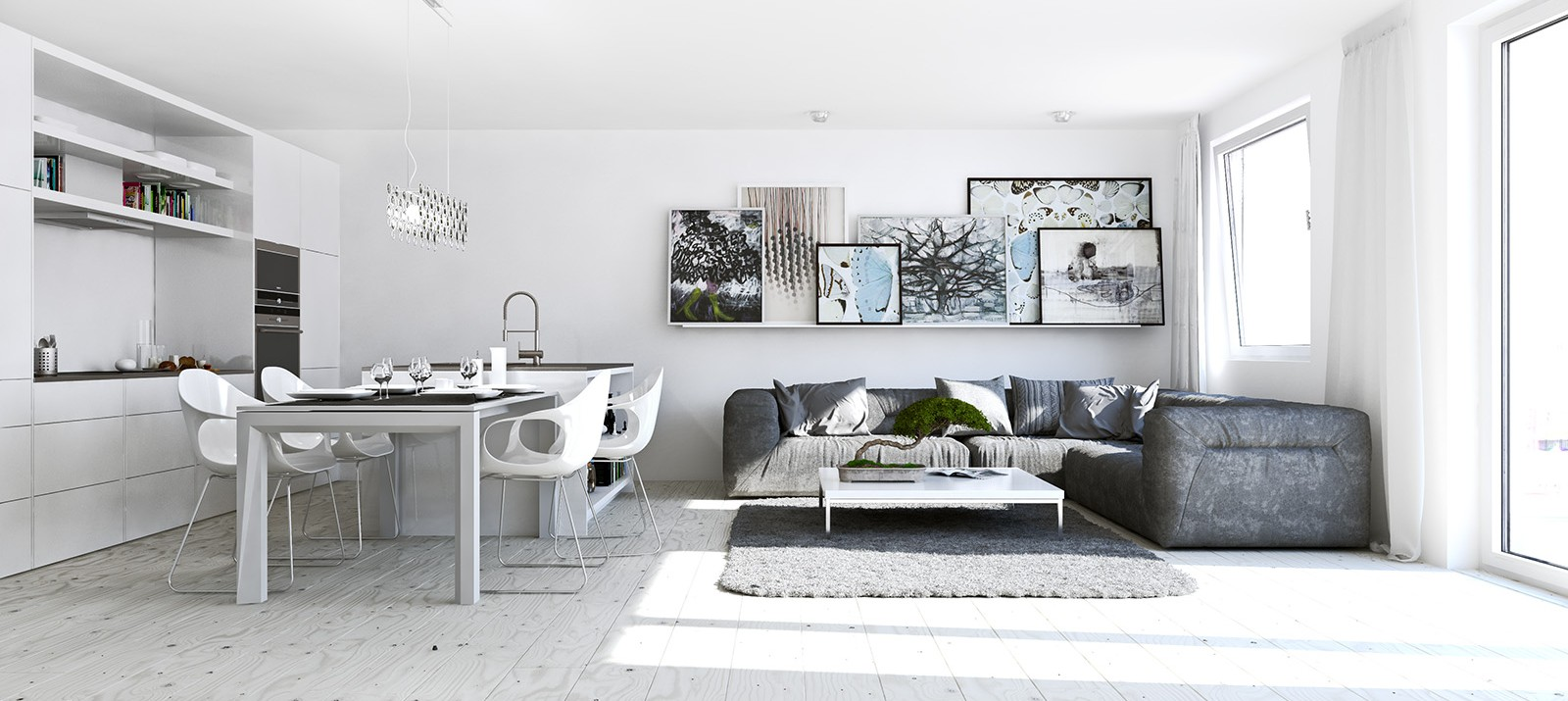 A white interior in a studio apartment reflects light to make a room feel bigger.