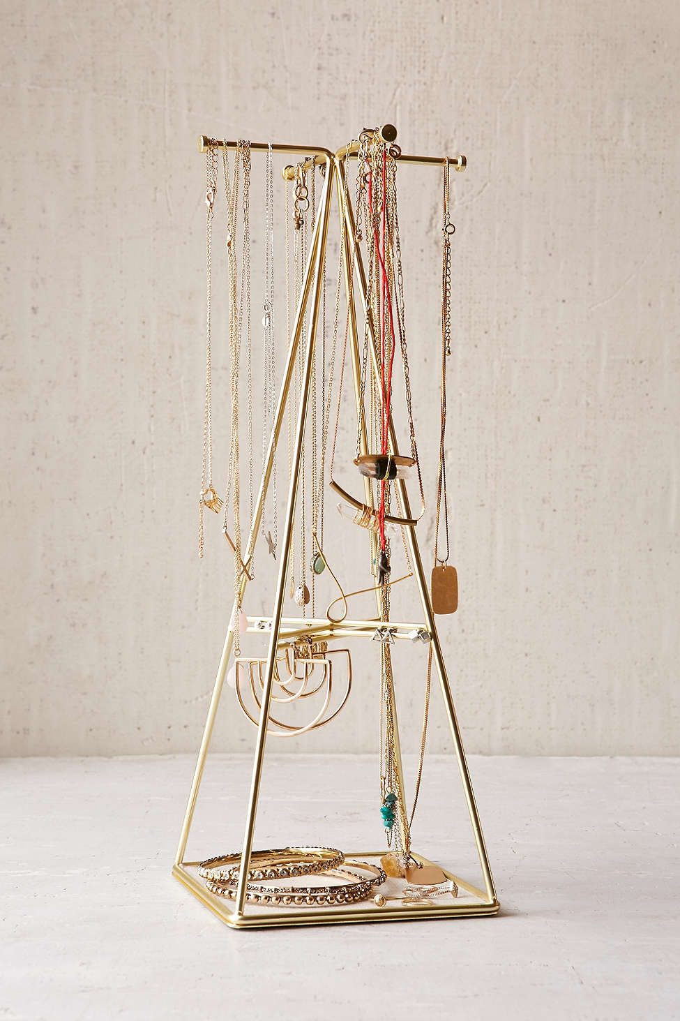 A brass-plated linen-lined Umbra Prisma Large Jewelry Organizer from Urban Outfitters is a perfect Valentine's gift for her.