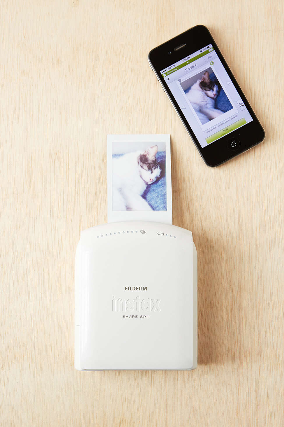 A Fujifilm Instax Instant Smartphone Printer printing cat images is one of various creative Valentine's Day gifts for her or him.