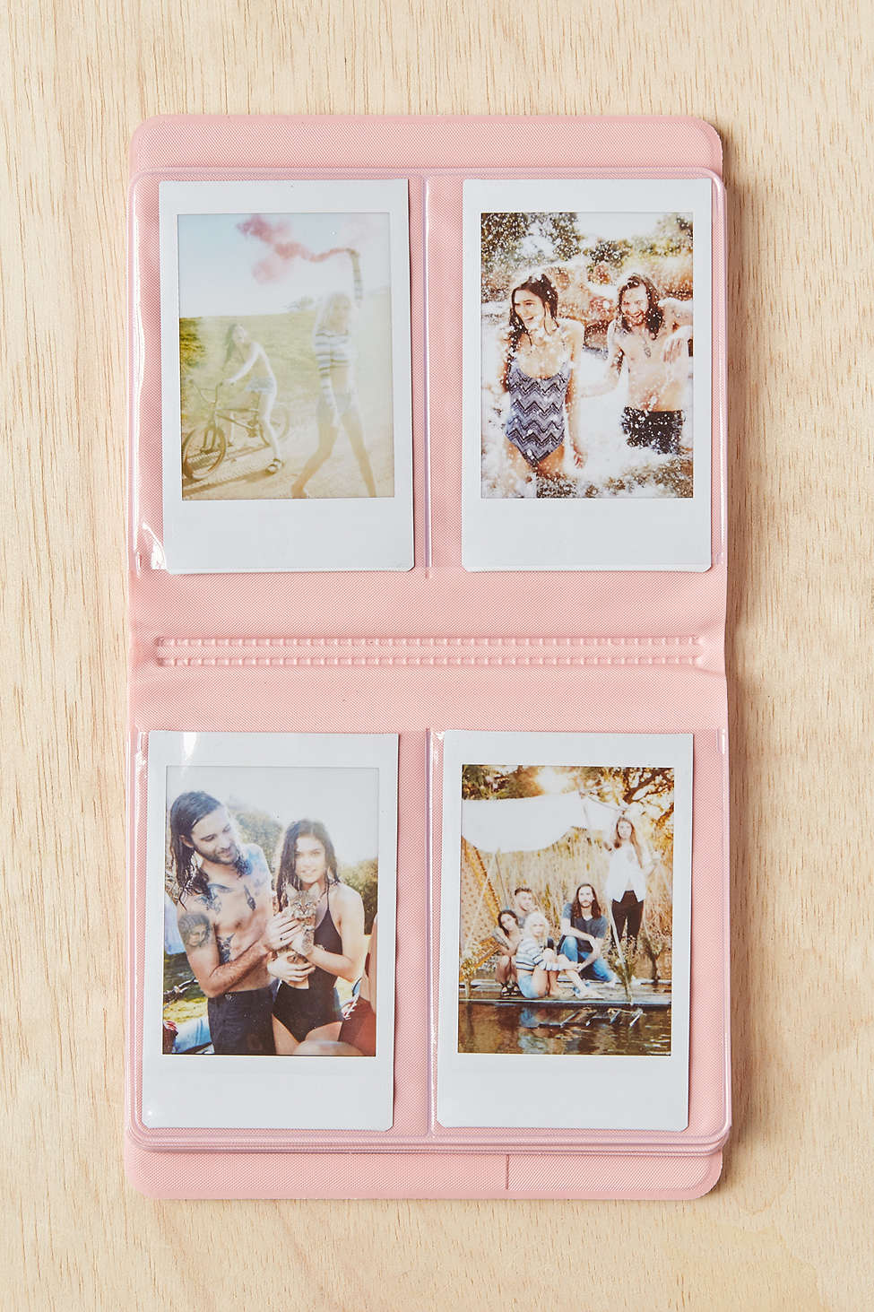 An Instax Photo Album from Urban Outfitters used for photograph storage is a creative Valentine's day gift for boyfriend or girlfriend.