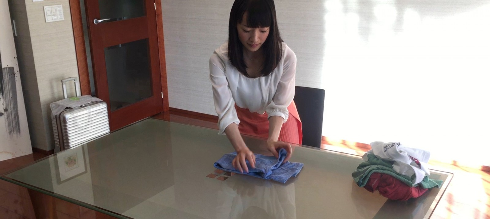 Marie Kondo shows how to fold a shirt the KonMari way.