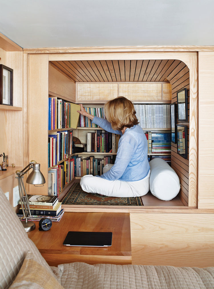 Building a wooden book cabinet under a loft bed is one of many smart book storage hacks.