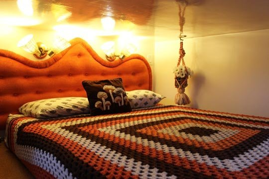"The cozy bedroom in Tracy and Marty Metro's ""Retro Metro"" houseboat."