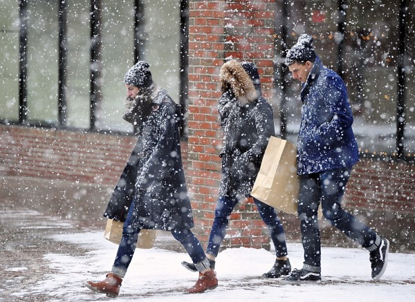 Two female and one male are shopping in Old Port, Maine, an easy way to cure cabin fever.