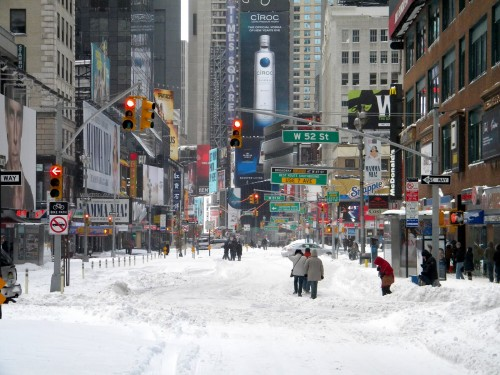 How to beat cabin fever: play in the snow at W 52nd St in Times Square, Manhattan.