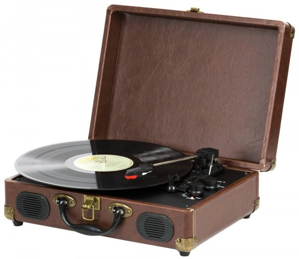 A brown QFX TURN-101 Retro Collection Suitcase Turntable is playing a vinyl record.