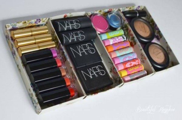 A DIY makeup storage and organizing solution made from Christmas gift boxes.