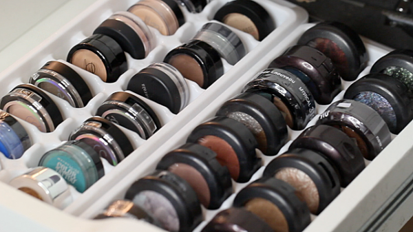 White ice cube trays used as an eyeshadow storage and organization solution.