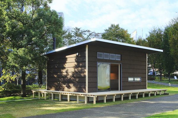 The exterior of a MUJI Cork Hut, a prefab home in Japan.
