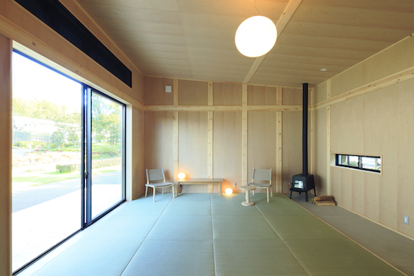 The interior of a MUJI Cork Hut, a minimal prefab house in Japan.