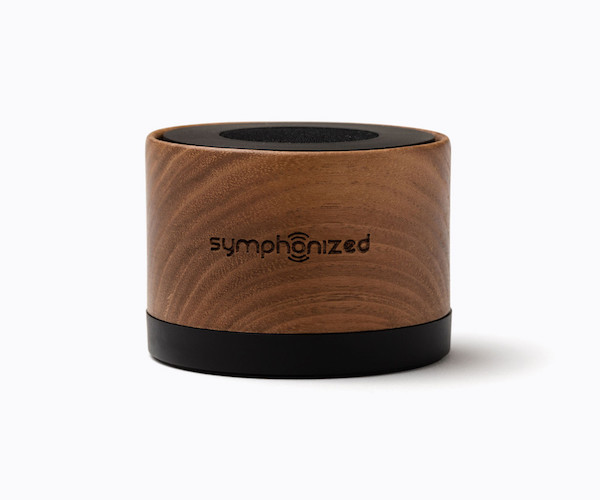 A small bamboo NXT Walnut Bluetooth Portable Speaker with a strong rubber bottom for stability