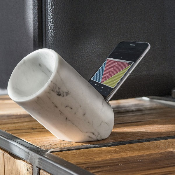 A small OVO iPhone speaker made of marble.