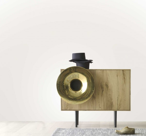 An oak veneered Caruso audio system with a pure gold plated horn is also a credenza with storage shelves.
