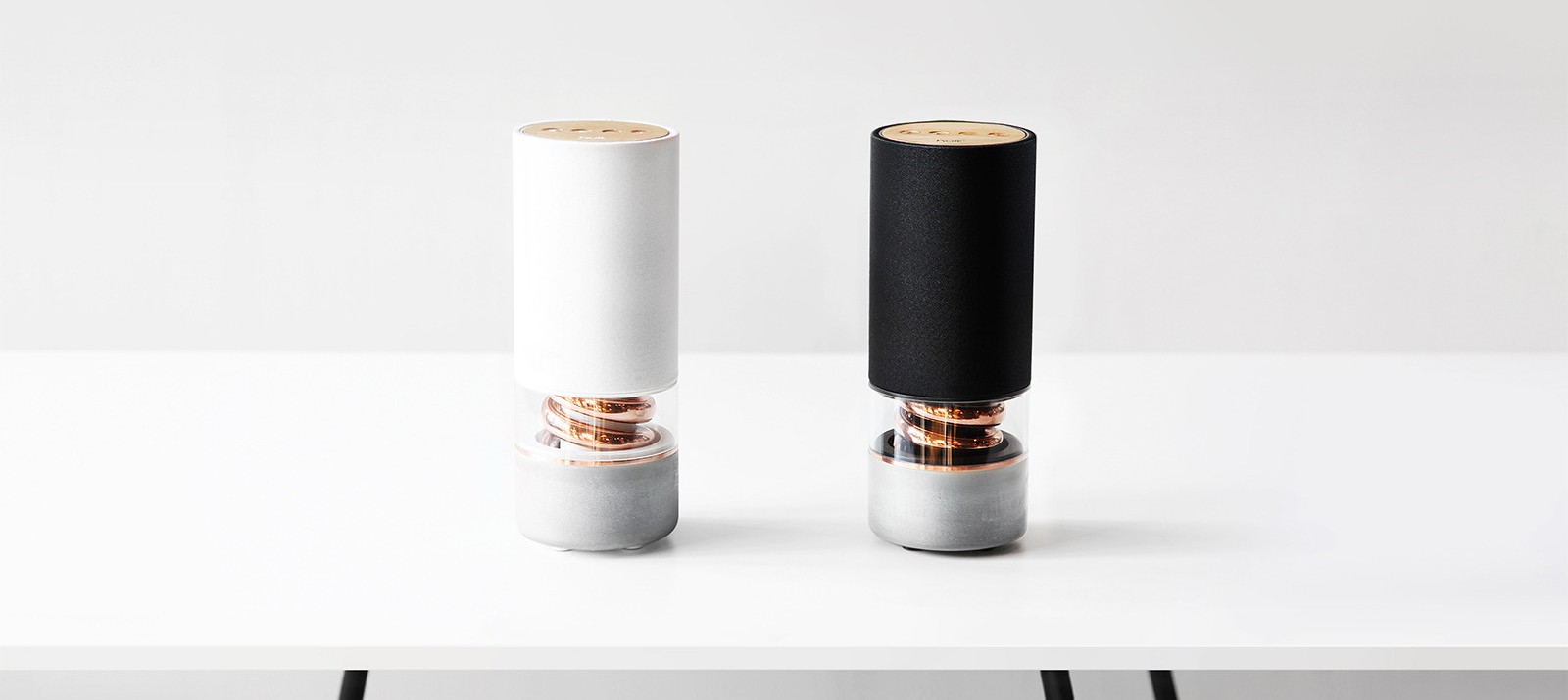 White and black Pavilion small speakers.