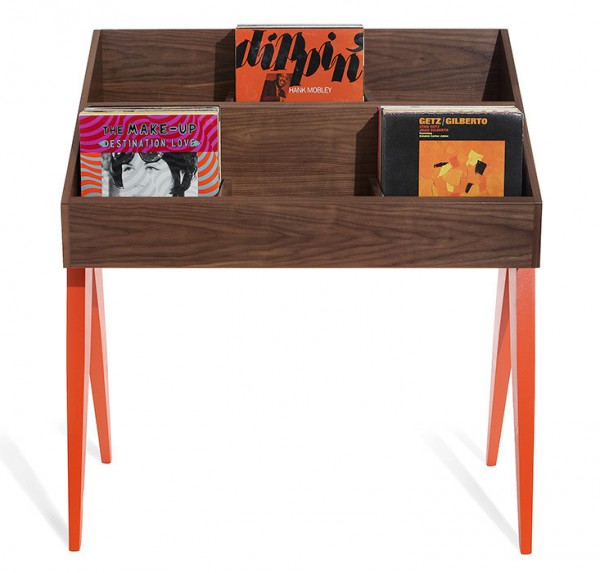An Atocha Design Record Stand that has a walnut base with solid American maple legs painted orangey-red.