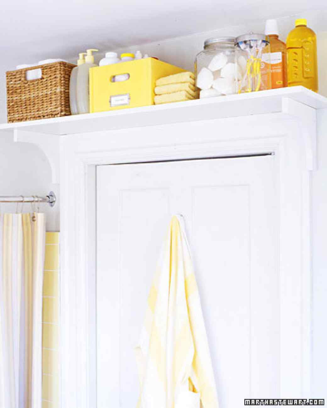 install a shelf on top of your bathroom door to store extra grooming and personal hygiene products