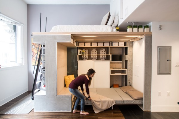 Nicki Wang tidies the Domino Loft system's Murphy bed.