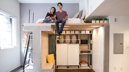 Treadfast owners Nicki and Donnie Wang sit on the Domino Loft system's bed in their 500-square-foot San Francisco apartment.
