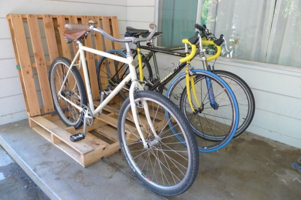 Lean two wooden shipping pallets against each other and voila, you have a new cheap bike rack.