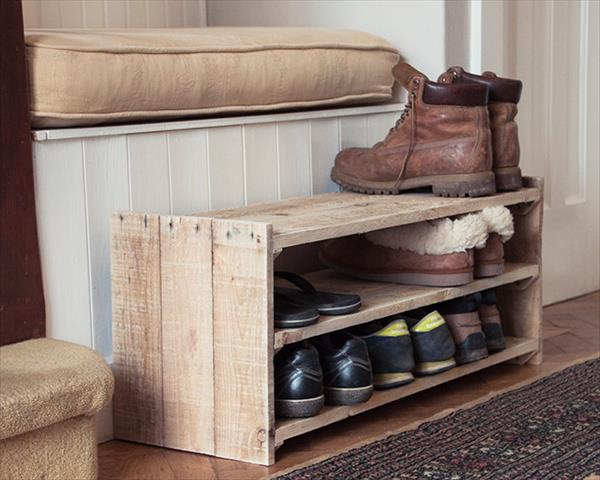 A small wood pallet shoe rack easily stores nine pairs of shoes, slippers, and boots.