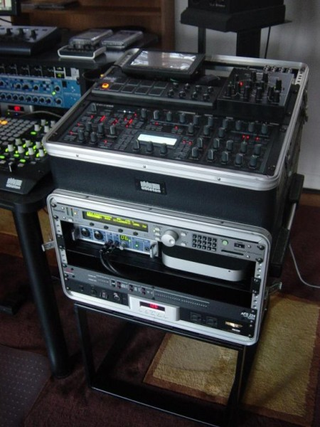 "a portable rack stores a 7"" lcd, m-resonator, lpd8, fireface 400, and mac mini"