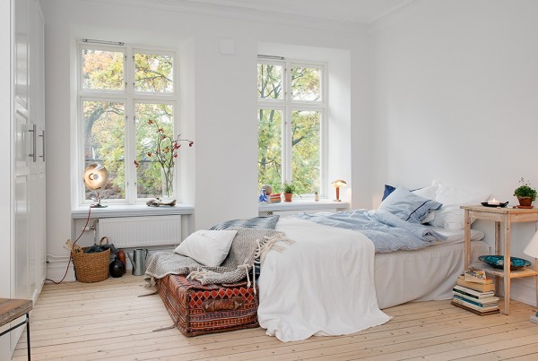A cozy bedroom in a 387 sq ft apartment in Sweden.