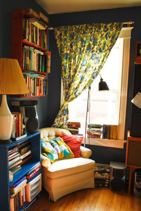 Move a chair in front of a window to create a cozy reading nook/personal space in your apartment.