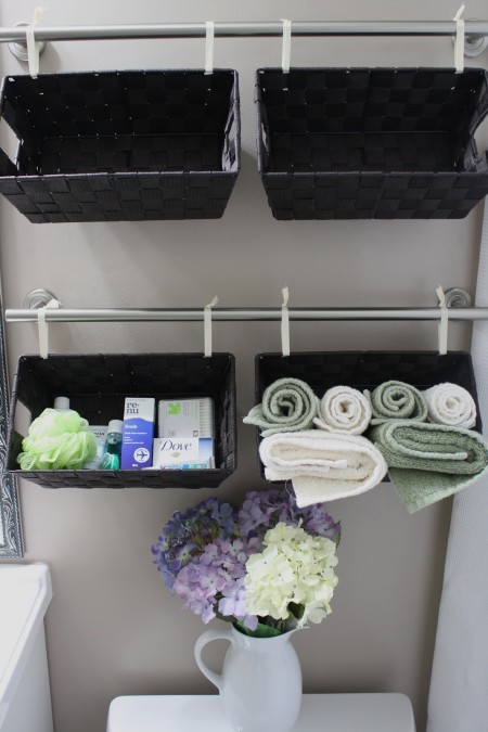 wall of a black baskets used for toiletry and towel storage - Bathroom Towel Storage