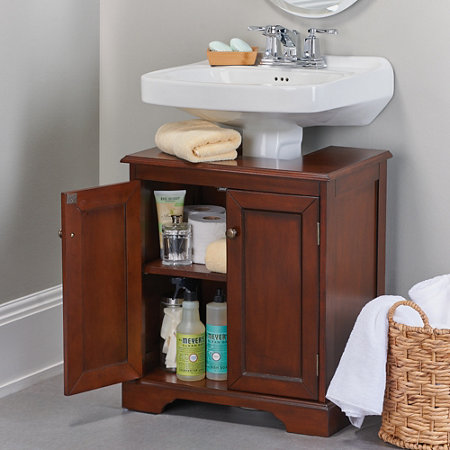 wooden weatherby bathroom pedestal sink storing bathroom cleaning supplies toilet paper and other toiletries