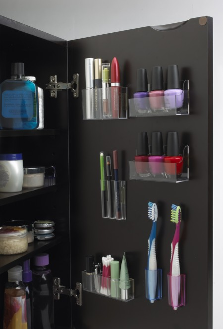 stickonpods medicine cabinet organizers storing makeup products, eye pencils, nail polish, tooth brushes, q-tips, a nail clipper, and more