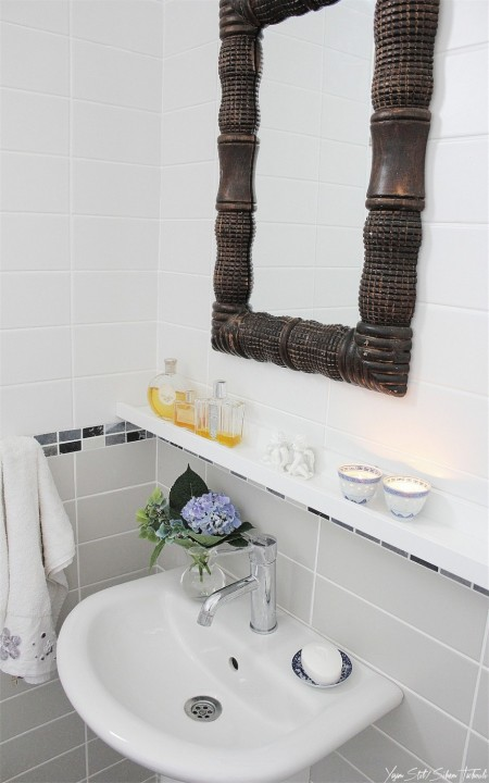 easy bathroom storage hack made from an ikea mosslanda picture ledge