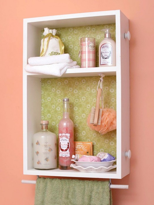 an upcycled old drawer as a bathroom wall-mounted mini storage unit